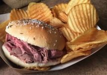 Beef on weck served with a side of chips