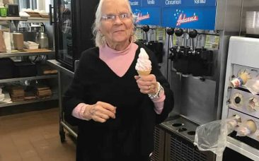 Greta Anderson holding a custard cone on her 101st birthday